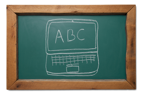 Image of chalkboard with computer and ABC written on it