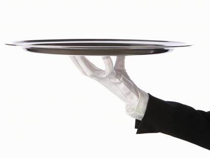 Image of butler arm with white glove holding tray